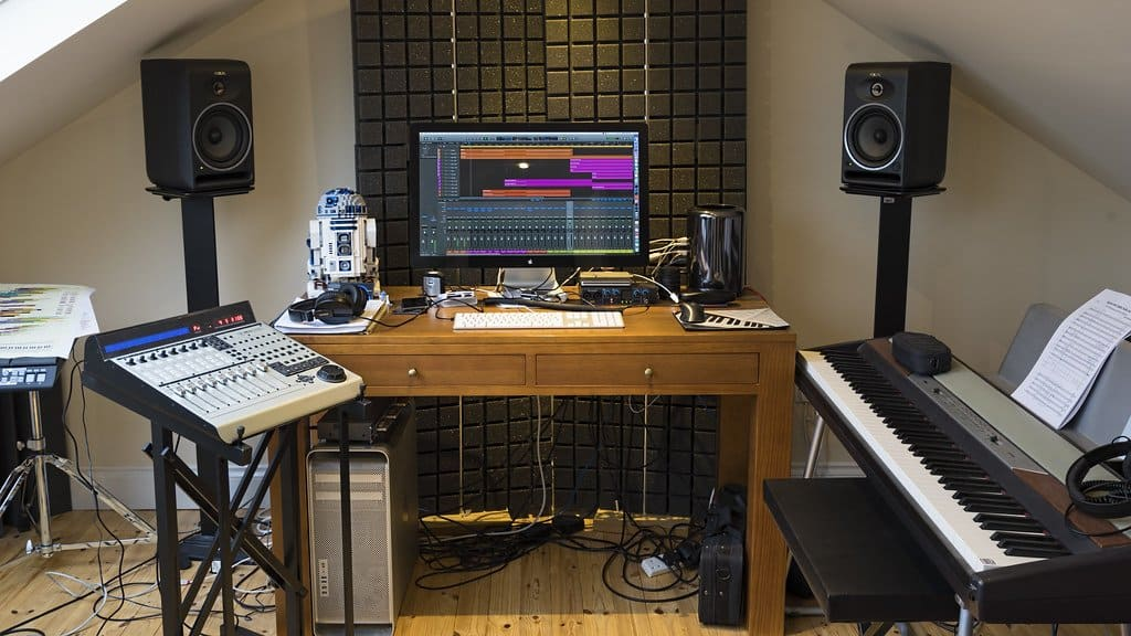 Studio monitors placed in a home studio